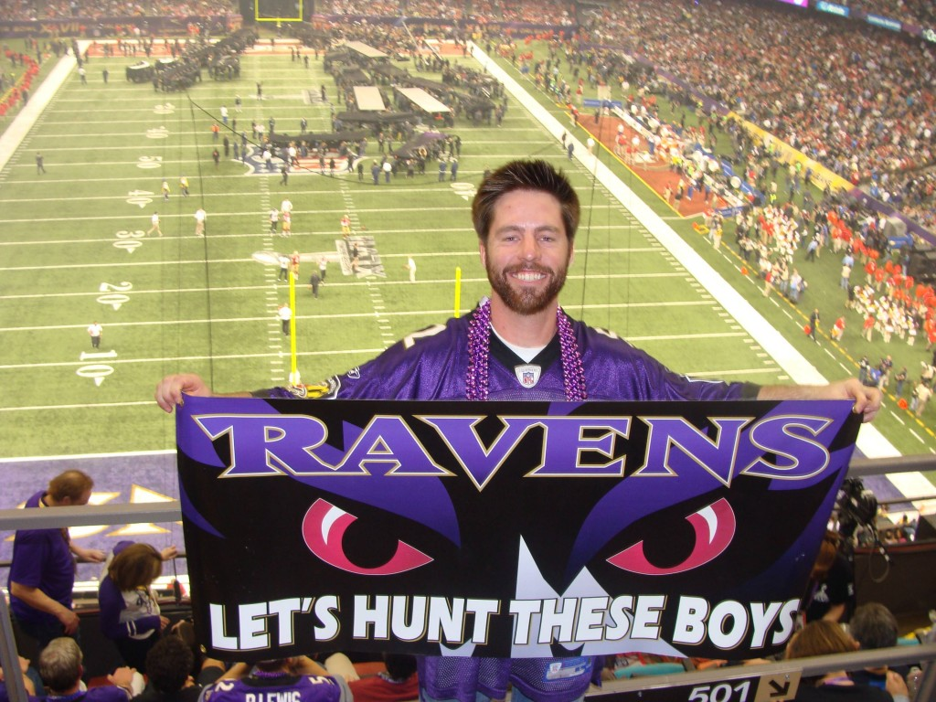 Ravens fan Mike Fast holds Ravens banner at Super Bowl XLVII in New Orleans.